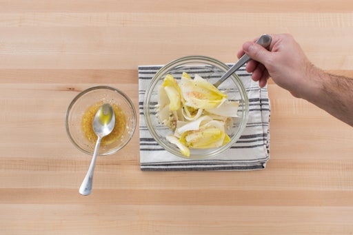 Dress the endive salad & serve your dish: