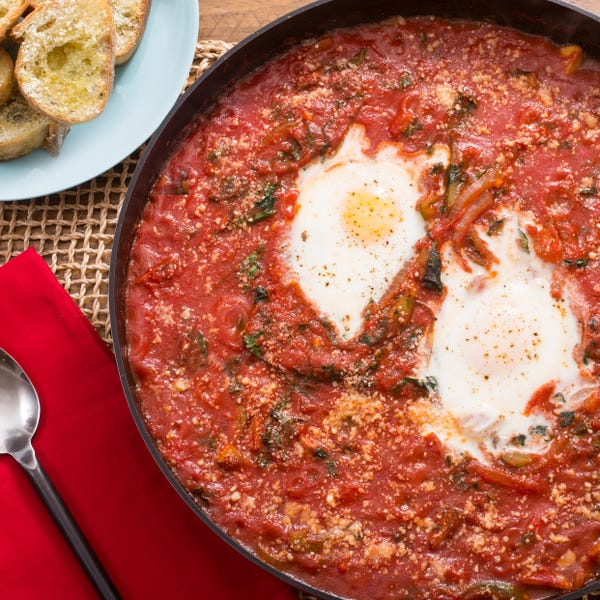 Cacciatore-Style Baked Eggs with Lacinato Kale & Parmesan-Garlic Toasts