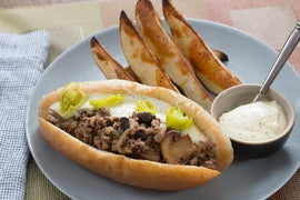 Italian Beef Grinders with Aged Cheddar Cheese Sauce & Crispy Potato Wedges