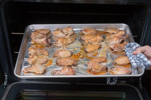 Roast the chicken wings:
