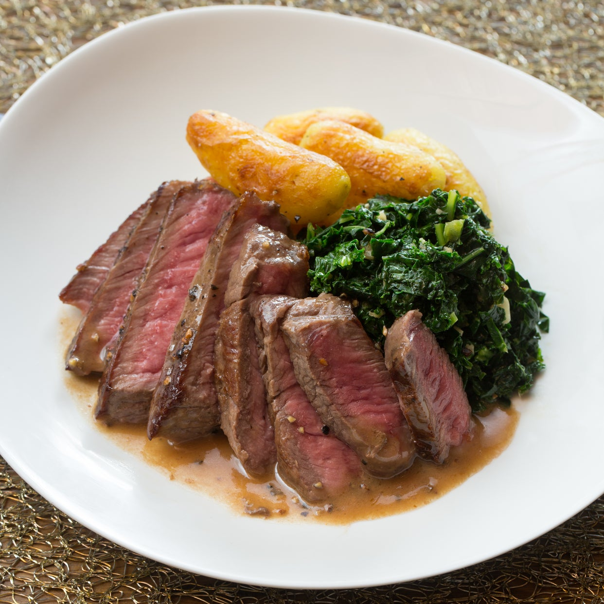 Steaks au Poivre with Crispy Fingerling Potatoes & Sautéed Kale