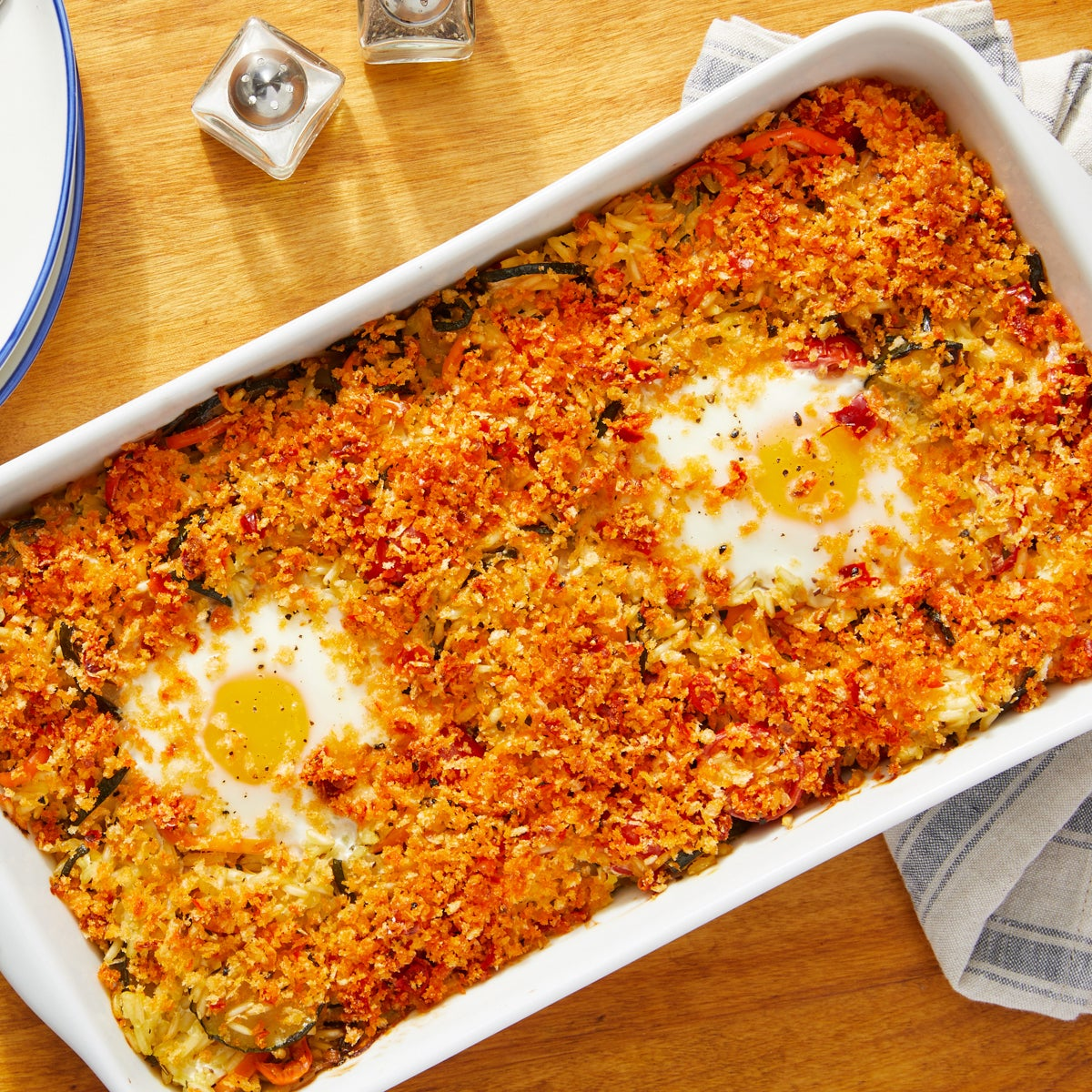 Baked Eggs & Saffron Rice with Zucchini, Tomatoes & Sweet Peppers