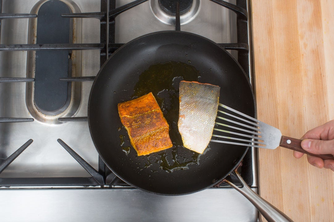 Coat & cook the salmon: