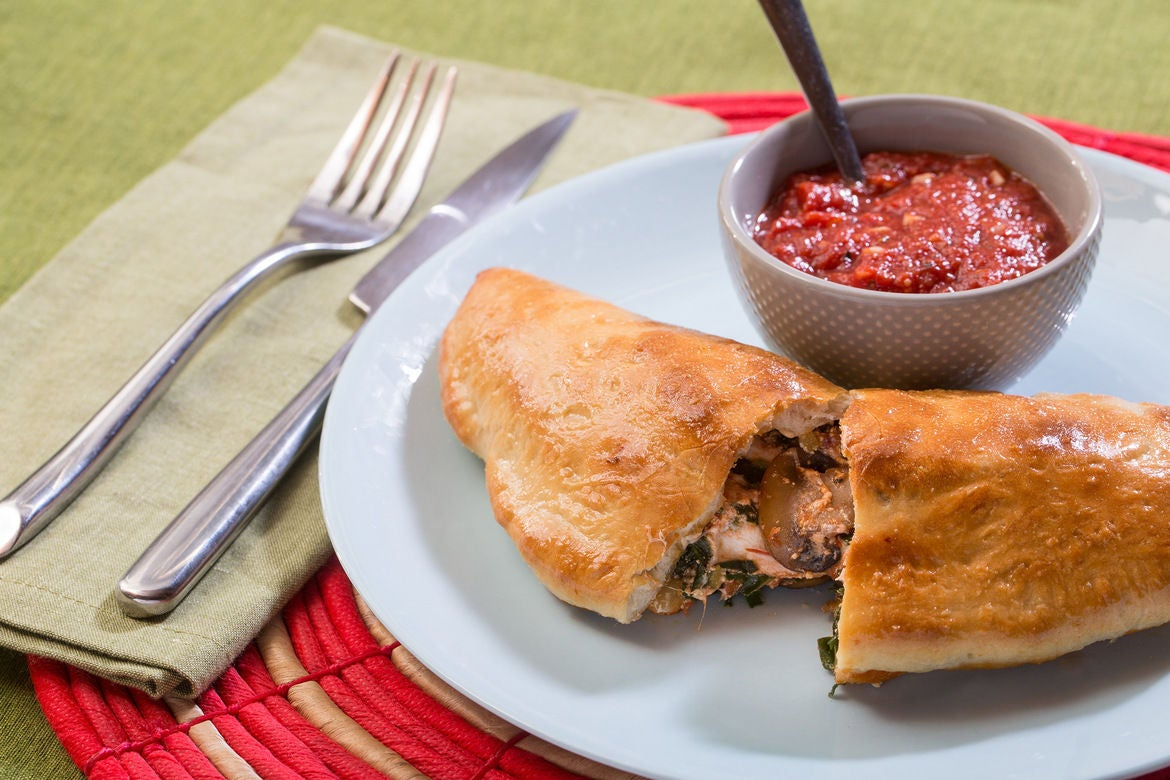 Mushroom & Collard Green Calzones with Fresh Mozzarella & Tomato Dipping Sauce