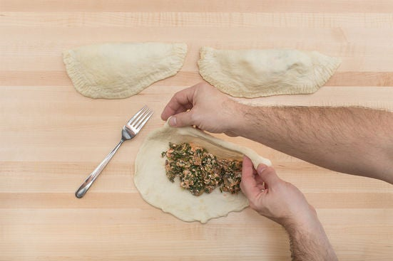 Assemble the calzones: