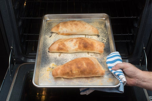Bake the calzones & plate your dish: