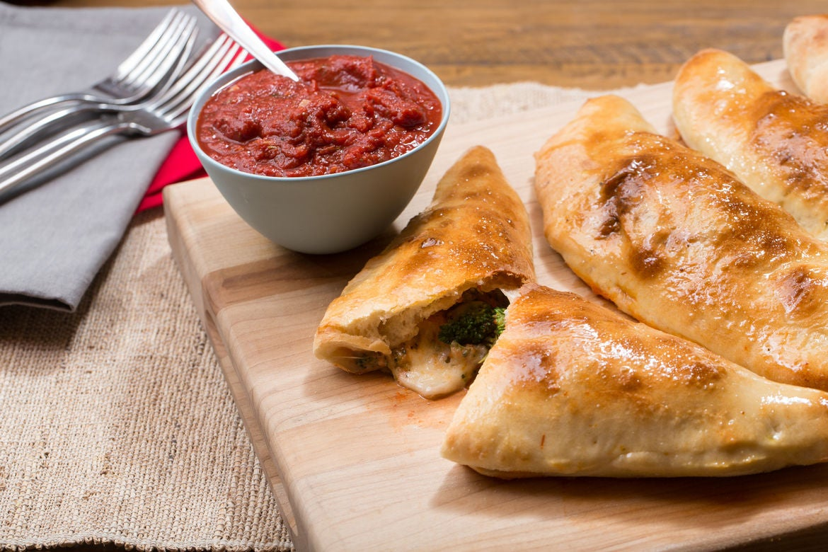 Cheesy Broccoli Calzones with Tomato Dipping Sauce
