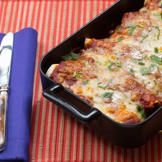 Cheesy Enchiladas Rojas with Mixed Mushrooms & Spinach