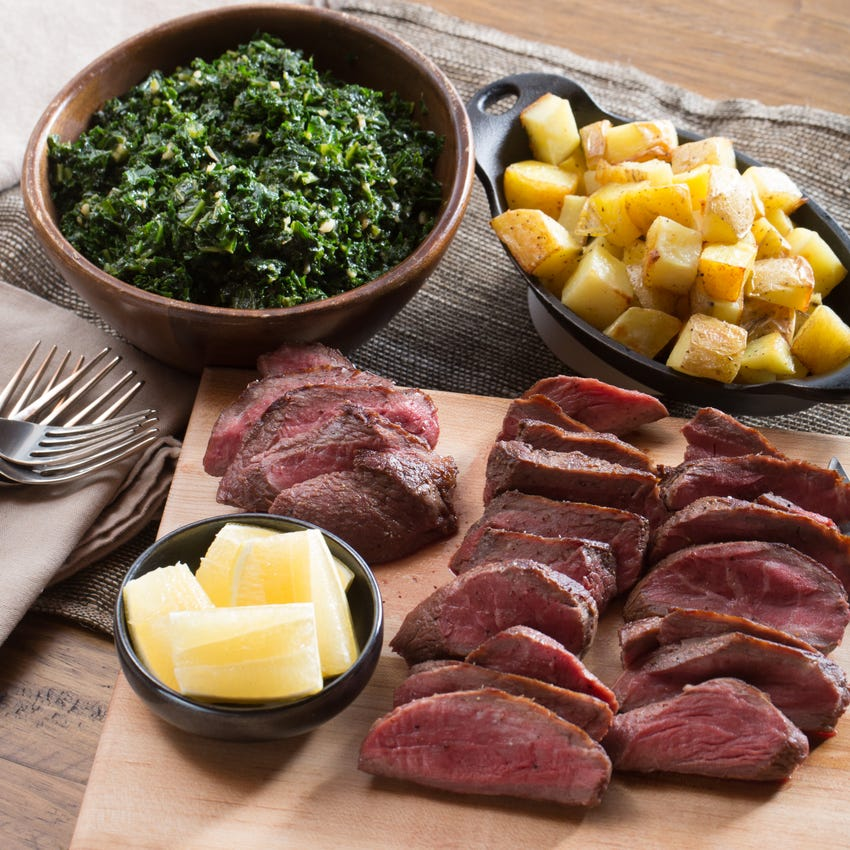 """Seared Sirloin Steaks with Roasted Potatoes & """"Creamed"""" Kale"""
