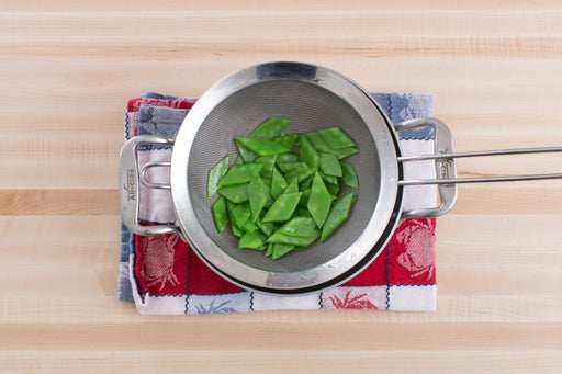 Blanch the snow peas: