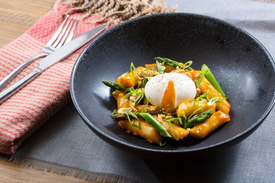 Spicy Vegetable Tteokbokki with Asparagus, Soft-Boiled Eggs & Ginger Cashews