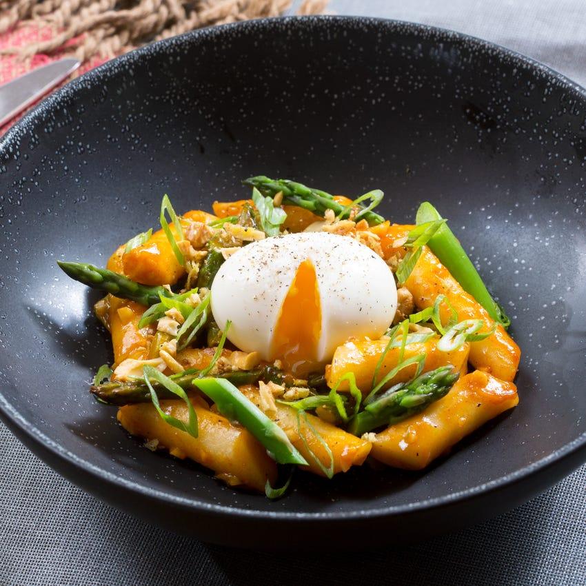 Spicy Vegetable Tteokbokki with Asparagus, Soft-Boiled Eggs & Ginger Cashews