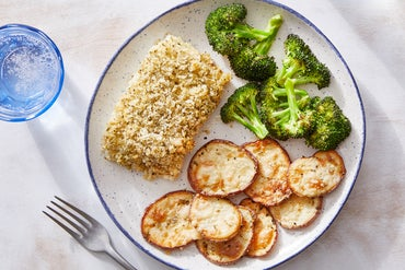 Grana Padano & Panko-Crusted Cod with Roasted Potatoes  & Lemon-Dressed Broccoli