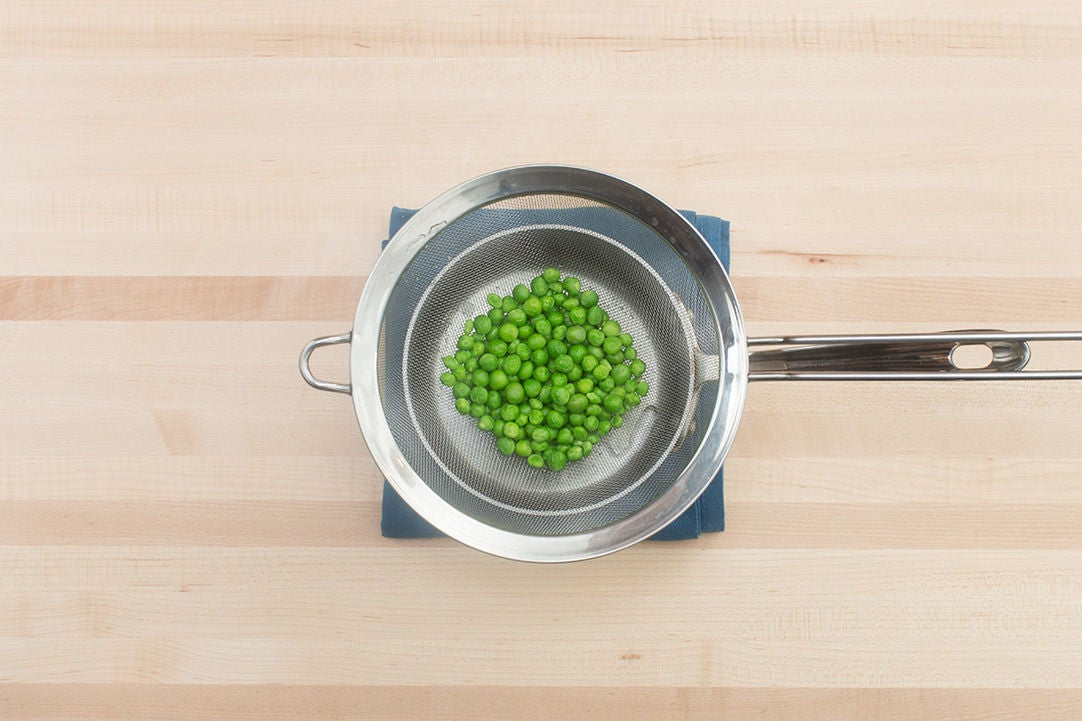 Blanch the peas: