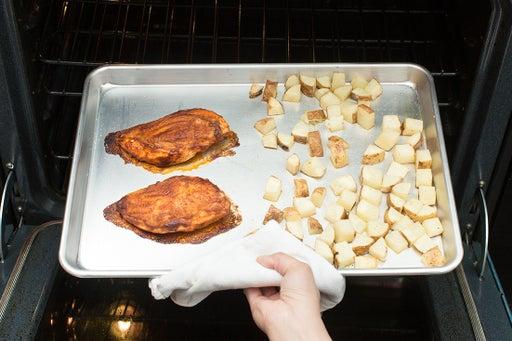 Roast the chicken & potatoes: