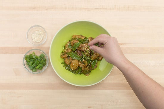 Add the pea shoots & plate your dish: