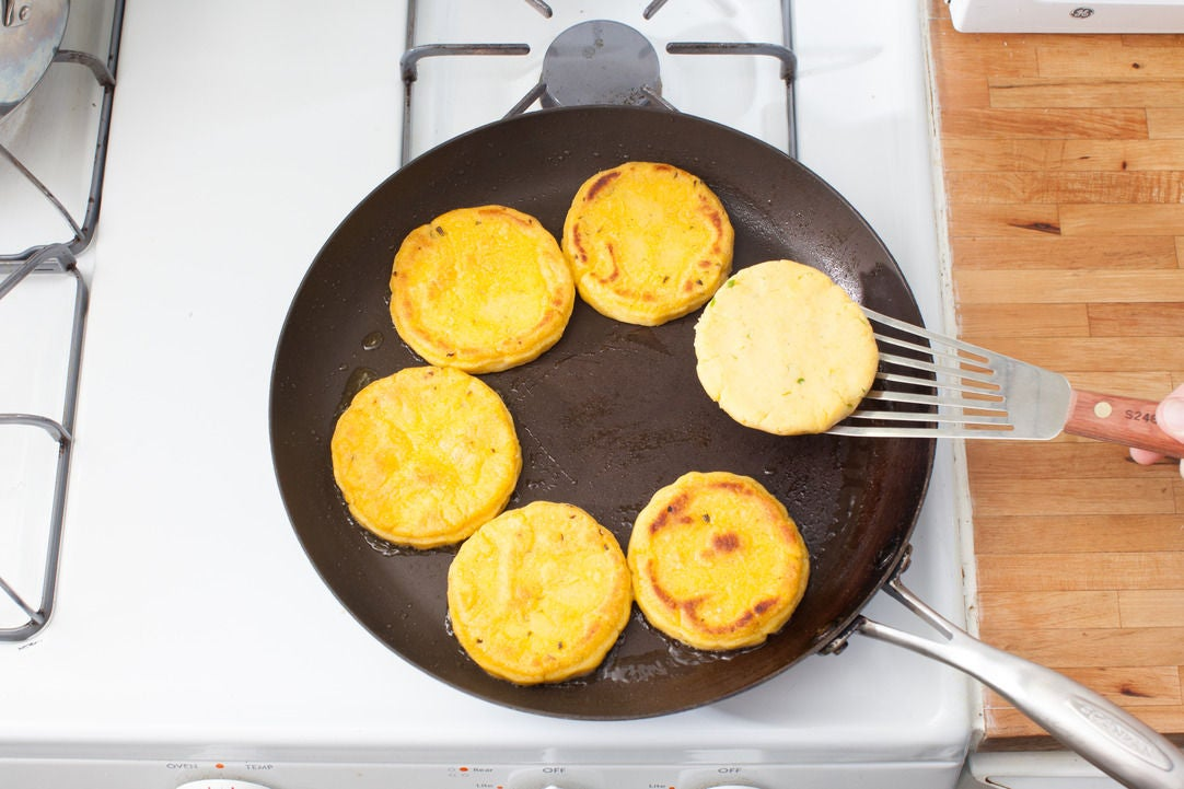 Cook the arepas: