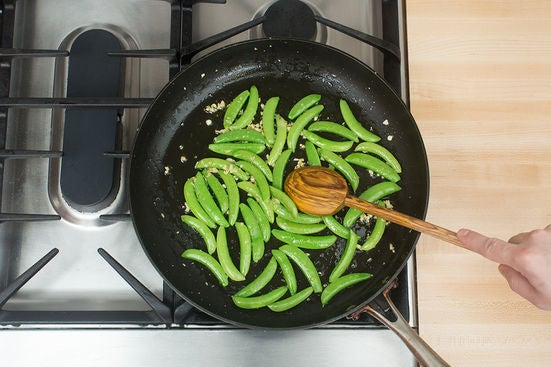 Cook the snap peas & serve your dish:
