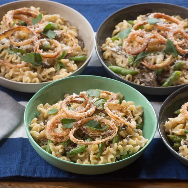 Creamy Mafalda Pasta with Green Beans, Maitake Mushrooms & Crispy Onion Rings