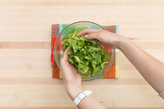 Dress the pea tips & plate your dish: