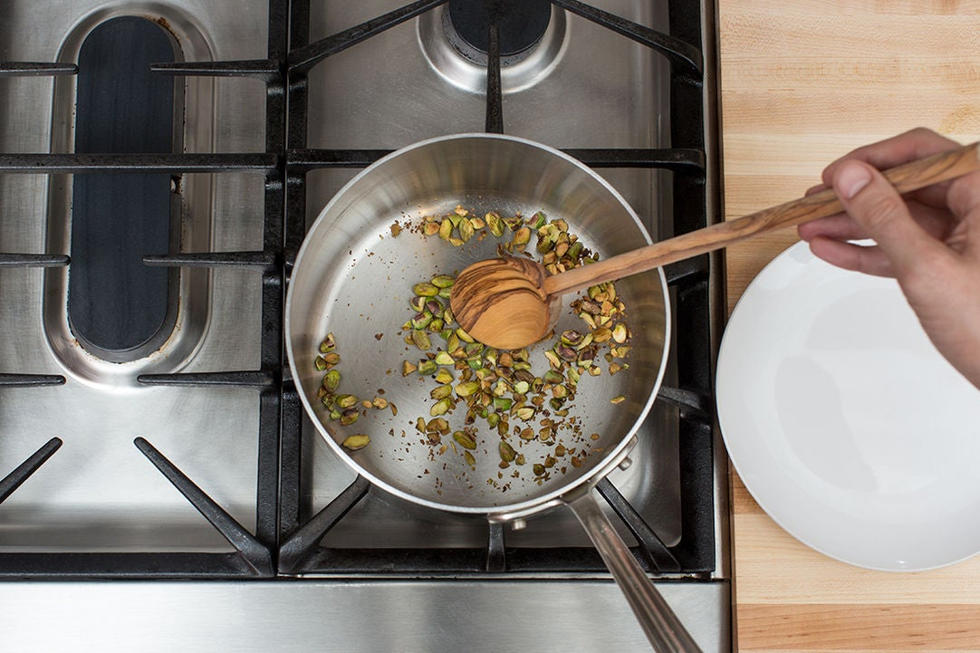 Toast the pistachios: