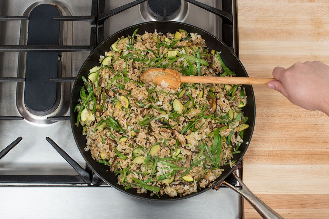 Add the rice, vegetables & sauce: