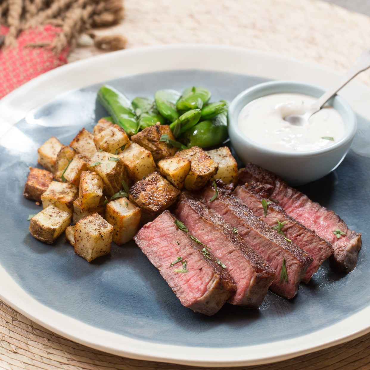 Seared Steak & Spiced Potato with Sautéed Sugar Snap Peas & Tarragon-Labneh Sauce