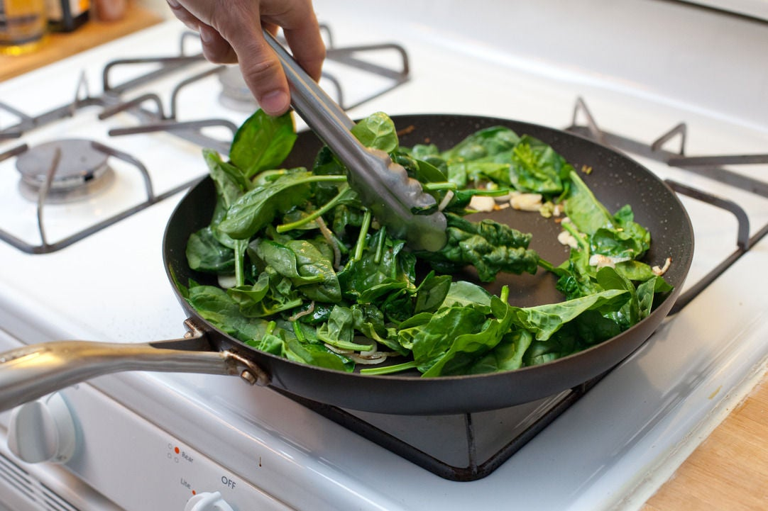 Cook the spring onion & wilt the spinach: