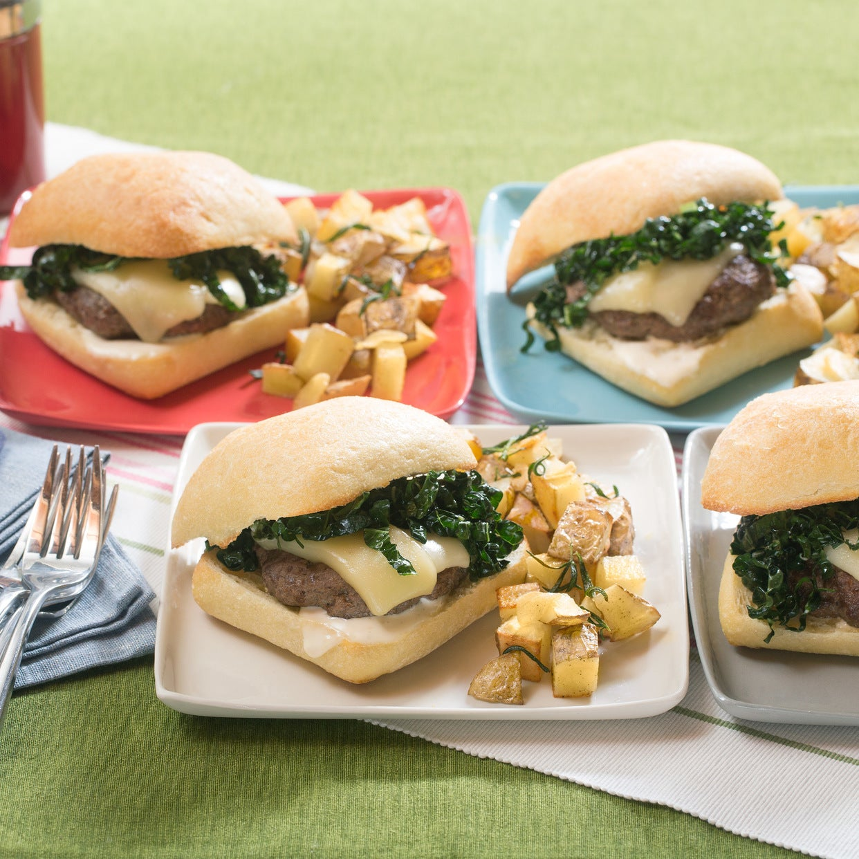 Fontina Cheeseburgers on Ciabatta with Garlic-Rosemary Potatoes
