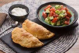 Empanadas de Picadillo with Tomato-Cucumber Salad & Lime Crema