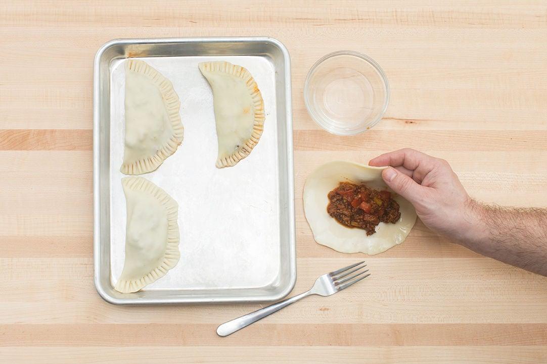 Assemble the empanadas: