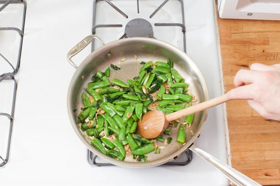 Cook the ramps & sugar snap peas: