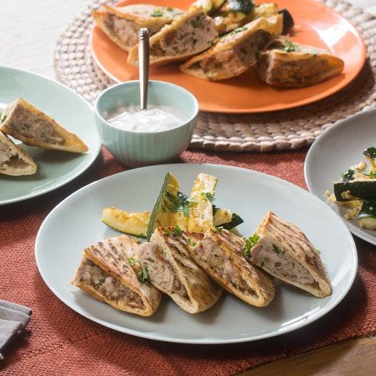 Spiced Turkey Arayes with Garlic-Almond Zucchini Wedges & Lemon-Yogurt Sauce