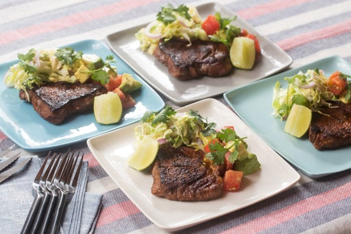 Spiced Steaks & Tomato-Avocado Salad with Creamy Cone Cabbage & Red Onion Slaw