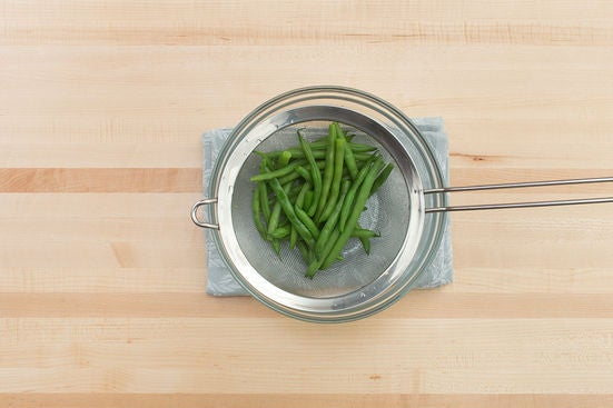 Blanch the green beans: