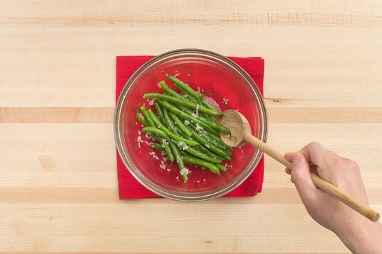 Dress the green beans & serve your dish: