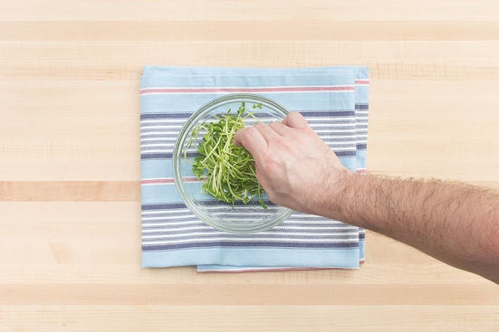 Dress the pea shoots & plate your dish: