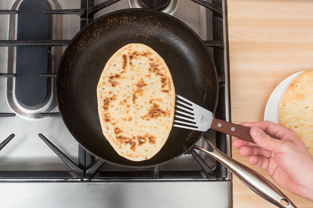 Warm the naan & serve your dish: