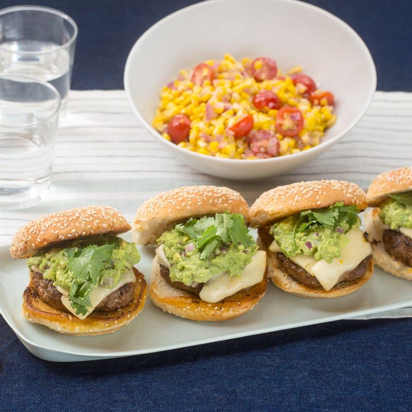 Southwestern Cheeseburgers with Guacamole & Sautéed Corn-Tomato Salad