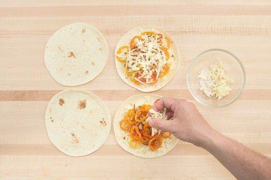 Assemble the quesadillas: