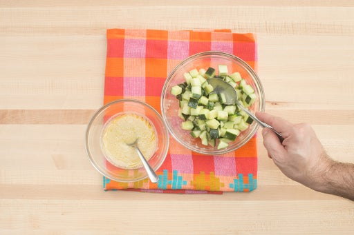 Make the dressing & marinate the cucumber: