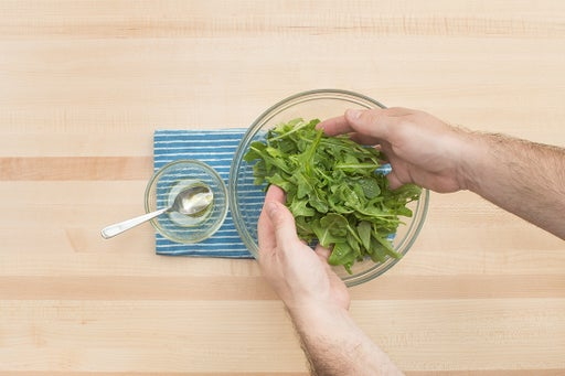 Dress the arugula & plate your dish:
