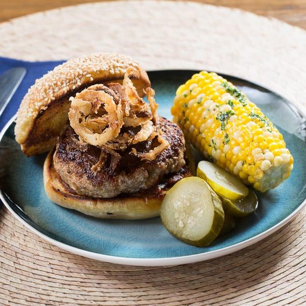 BBQ Pork Burgers & Corn on the Cob with Crispy Onion Rings & Garlic-Herb Butter