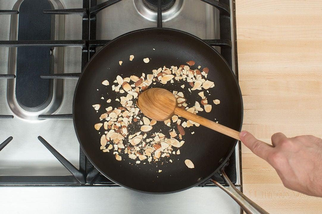 Toast the almonds: