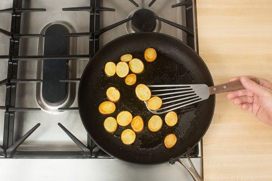 Brown the potatoes: