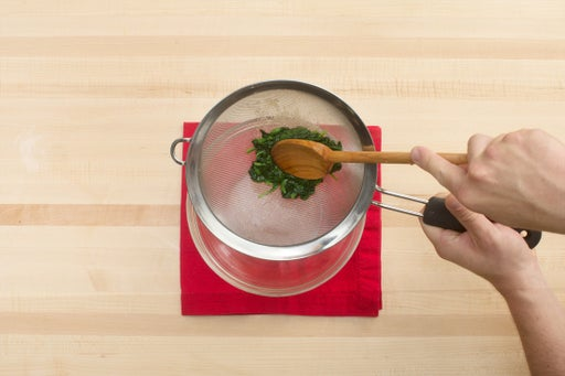 Cook & drain the spinach: