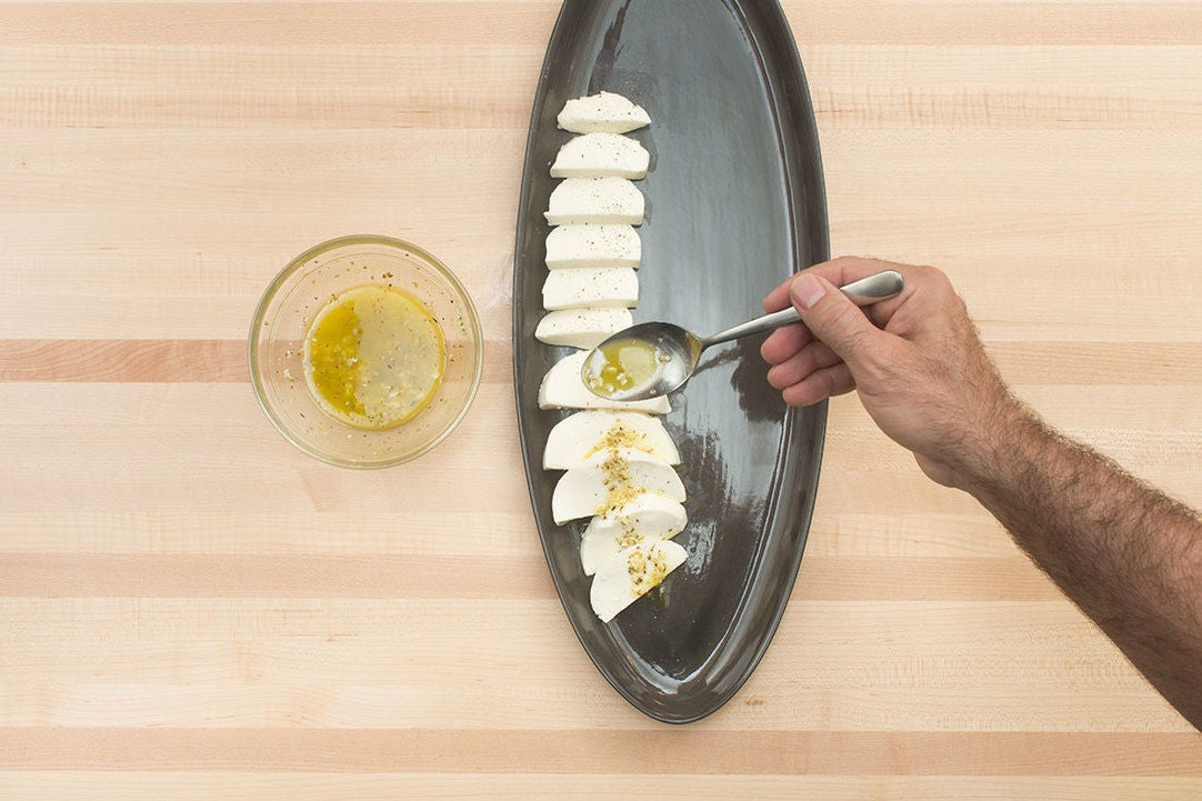 Make the dressing & marinate the mozzarella: