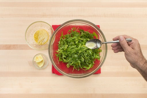 Dress the arugula & serve your dish: