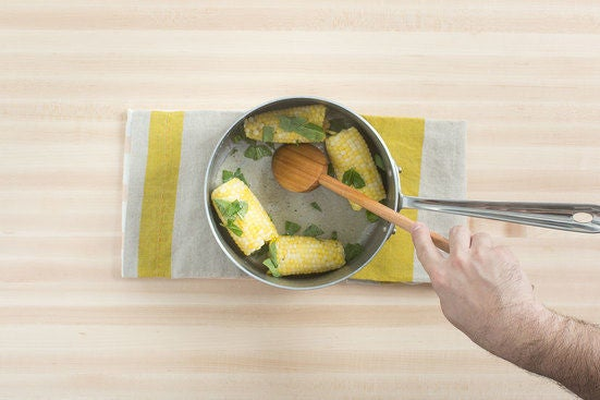 Dress the corn & serve your dish:
