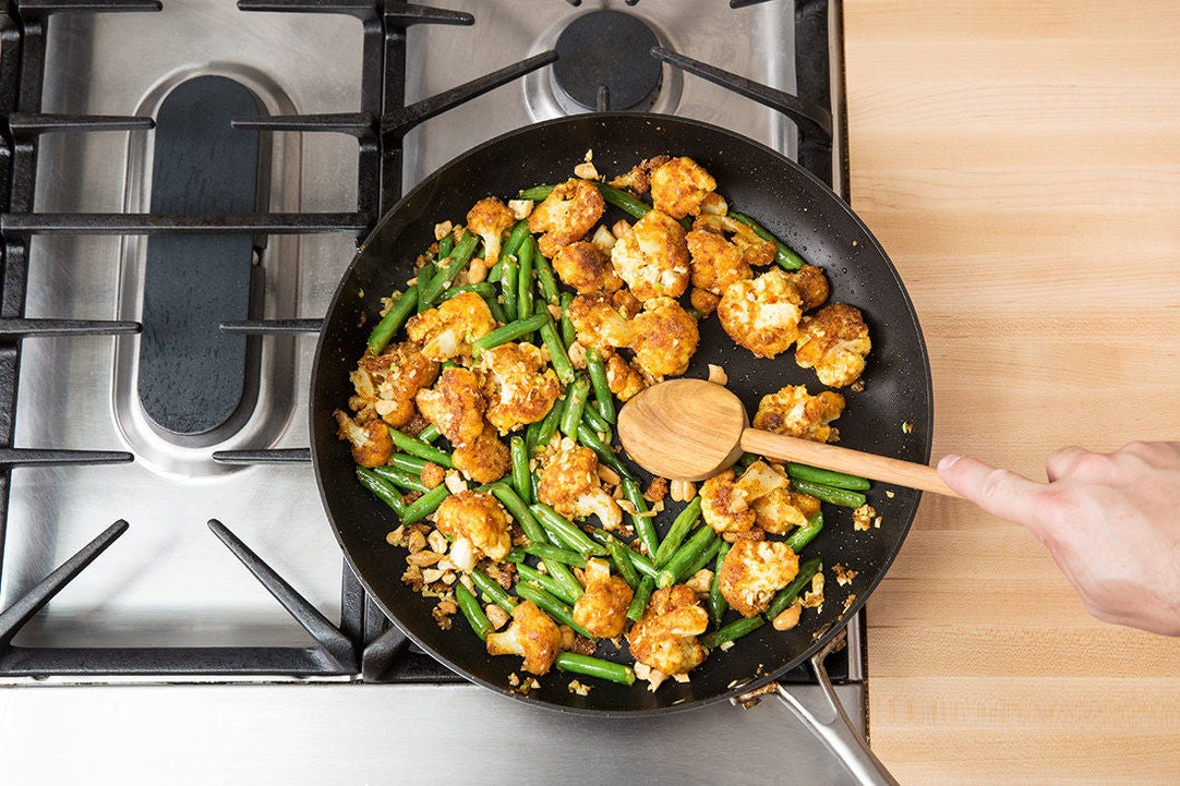 Add the green beans & aromatics: